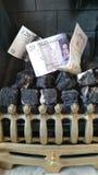 Costi di riscaldamento di un fuoco di gas Immagine Stock