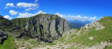 Costila steep cliffs, Bucegi mountains. View of the Costila peak and steep cliffs from the Caraiman Stock Photo