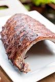 Costillas de cerdo asadas a la parrilla Fotografía de archivo libre de regalías