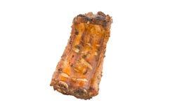 Costillas de cerdo asadas a la parrilla aisladas imagen de archivo