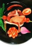 Costillas y verduras del cordero Imagen de archivo libre de regalías