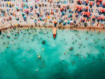 Aerial Drone View Of People Crowd Having Fun And Relaxing On Costinesti Beach In Romania stock photos