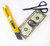 Costing depicted by a cutter and scissors Stock Photo