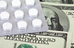Costly Daily Medication and money. Costly Daily Medication on a money background stock photo