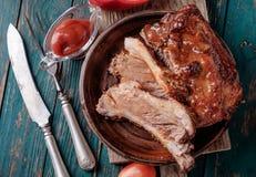 Costole arrostite col barbecue deliziose esperte con una salsa d'unto piccante Immagini Stock