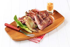 Costole arrostite della carne di maiale Immagini Stock Libere da Diritti