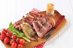 Costole arrostite della carne di maiale Fotografie Stock