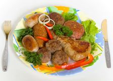 Costoletas da carne e salsicha pequena Fotografia de Stock