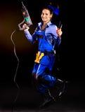 Costruttore della donna con gli strumenti della costruzione. Fotografie Stock Libere da Diritti