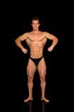 Costruttore di corpo, posa di concorso fotografia stock