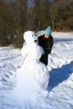 Costruzione del pupazzo di neve Fotografia Stock Libera da Diritti