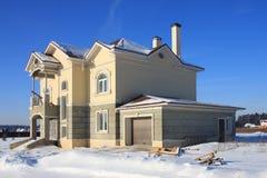 Costruzione della casa suburbana. Inverno. Fotografia Stock