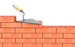 Costruzione della parete di mattoni e del Trowel Fotografie Stock Libere da Diritti