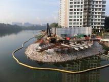 Costruzione della riva del fiume Immagini Stock