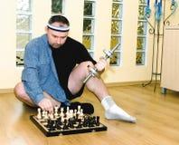 Costruzione di corpo o di scacchi? Fotografie Stock Libere da Diritti