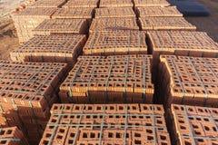 Costruzione di edifici dei pallet del mattone Immagini Stock