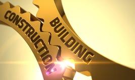 Costruzione di edifici sugli ingranaggi metallici dorati del dente 3d rendono Immagine Stock
