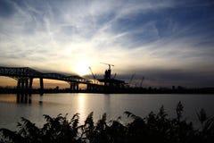 Costruzione di ponte al tramonto Fotografie Stock