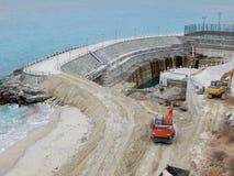 Costruzione di una diga marina immagini stock
