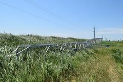 Costruzione di una linea elettrica ad alta tensione Immagini Stock