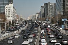 Costruzione ed automobili della città Fotografia Stock