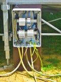 Costruzione elettrica dell'installazione di una linea elettrica Fotografia Stock
