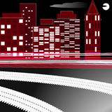 Costruzioni nella città/traccia dall'automobile sulla strada Fotografie Stock