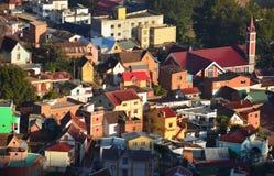 Costruzioni variopinte e case a Antananarivo, la capitale Fotografia Stock