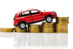 Costs of a car. Symbol photo with car and coins stock image