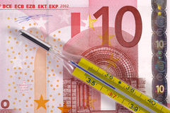 Costs of health. Medical thermometer on euro banknote as symbol for costs of health Royalty Free Stock Photography