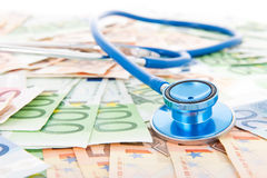 Costs of health care. Costs of healthcare with banknotes and stethoscope Royalty Free Stock Images