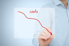 Costs reduction. Costs cut, costs optimization business concept. Businessman draw simple graph with descending curve Stock Images