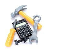 Costs or renovation and home improvements. Concept with a calculator surrounded by a hammer, spanner, screwdriver and nuts and bolt on a white background with stock photos