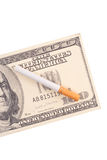 The Costs of Smoking. With Fake Hundred Dollar Bill Royalty Free Stock Photo