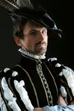 Costume. Portrait of a handsome man grandee in 16th century costume. Shot in a studio Stock Photos