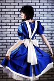 Costume of alice. Portrait of a young woman dressed as Alice in Wonderland, video game Stock Photo
