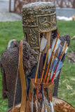 Costume of archer dacian. Consisting of a metal links shirt, arrows and a metal helmet with decorations Royalty Free Stock Image