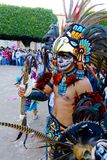 Aztec Warrior represented by a person with costume and accessories. Costume Aztec warriors with shield and ax Stock Photography
