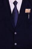 Costume d'homme d'affaires avec l'argent et un stylo dans la poche Images stock