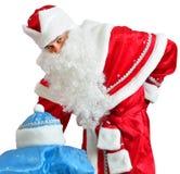 Costume de Santa Claus et de jeune fille de neige Photo libre de droits