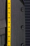 Costume et ruban métrique Photographie stock libre de droits