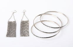Costume jewellery. Silver bracelet and Ear rings on a white background Stock Image
