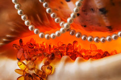 Costume jewellery - amber and pearls. Stock Photography