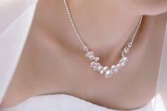 Costume Jewelry detail. On bride's neck Stock Photo
