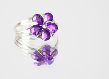 Costume jewelry ring on mirrored surface Royalty Free Stock Photos