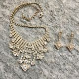 Costume jewerly. Necklace and earrings on stone stock photos
