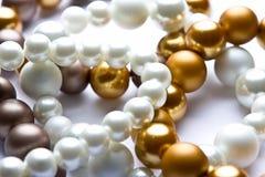 Costume Juwelery. Pearl designer costume jewelery in macro on white background Royalty Free Stock Photos