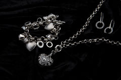 Costume Juwelery. Silver designer costume juwelery on black velvet background Stock Image