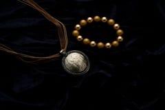 Costume Juwelery. Silver designer costume juwelery on black velvet background Royalty Free Stock Photos