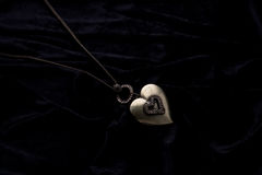 Costume Juwelery. Silver designer costume juwelery on black velvet background Stock Images
